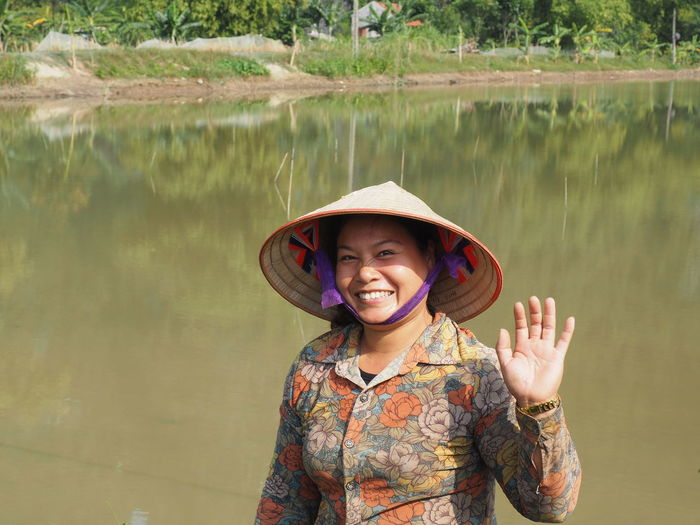 'The inland Ha Long Bay' Water Portrait One Person Clothing Looking At Camera Smiling Standing Happiness Lifestyles Emotion Hat Real People Woman Portrait