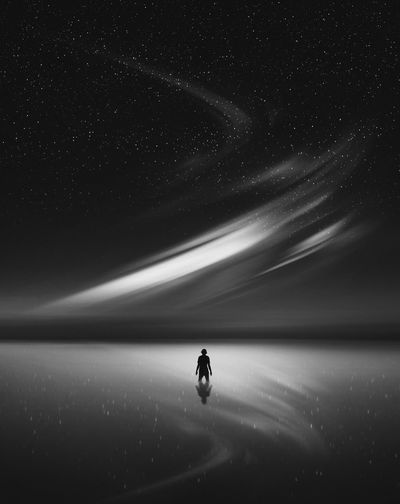 Silhouette Silhouette Photography Digital Composite Digital Imaging Digital Imaging Photoshop Photomanipulation Blackandwhite Black&white Photography Star - Space Aurora Sky Nightsky Night Water Space Motion One Person Sea Horizon Over Water Beauty In Nature Star Field Long Exposure Scenics - Nature Star