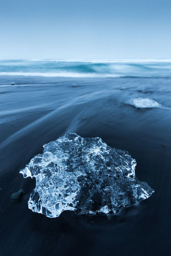 Next to the Jölusarlon Glacier Lagoon, Iceland Beach Black Cube Day Geology Horizon Over Water Ice Iceland Jökulsárlón Landscape Nature No People Outdoors Planet Earth Sand Scenics Sea Sky Water Waves Wet