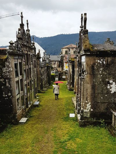 Visting Relatives Cementary Tranquility Raining Rain Umbrella Grass Green Red Stone History