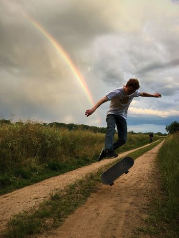 Skateboarding 360flip Germany Rainbow Sunset