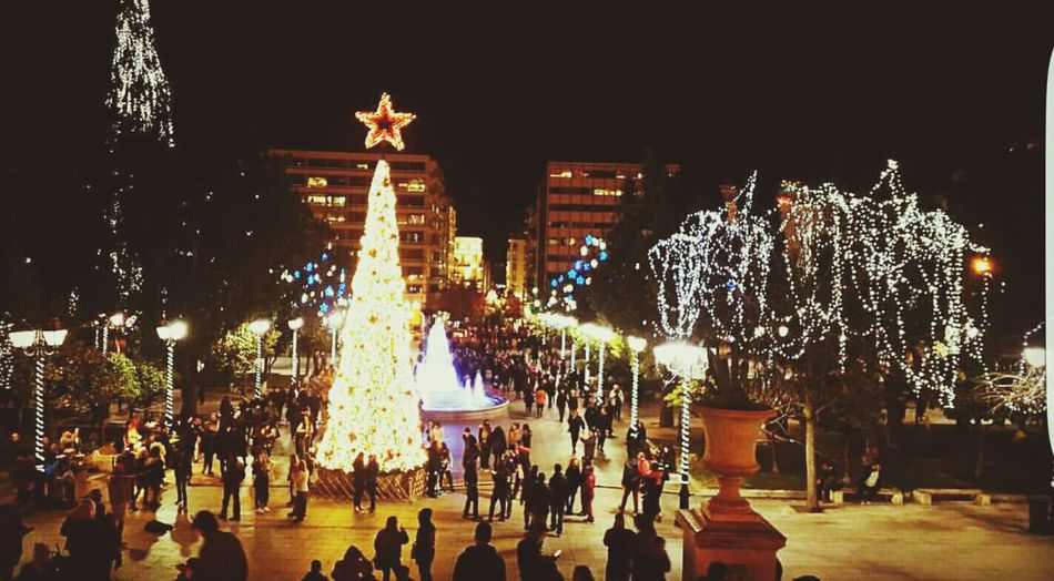 The Culture Of The Holidays Illuminated Night Large Group Of People Statue Architecture Built Structure Building Exterior Sculpture City Life City Leisure Activity Tree Person Modern Sky Monument Tourism Vacations
