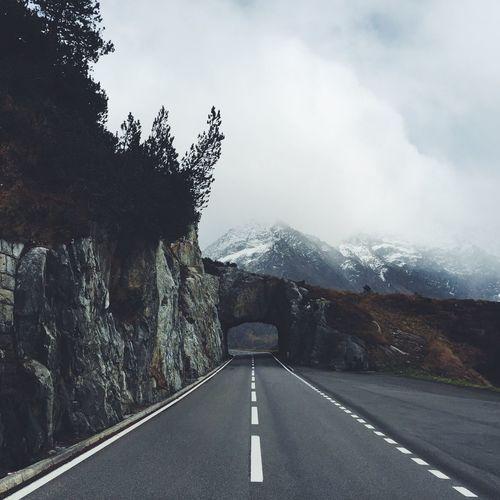 Empty Road Leading Towards Tunnel