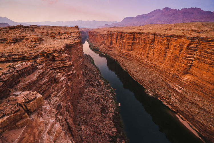High angle view of river amidst mountains during sunset