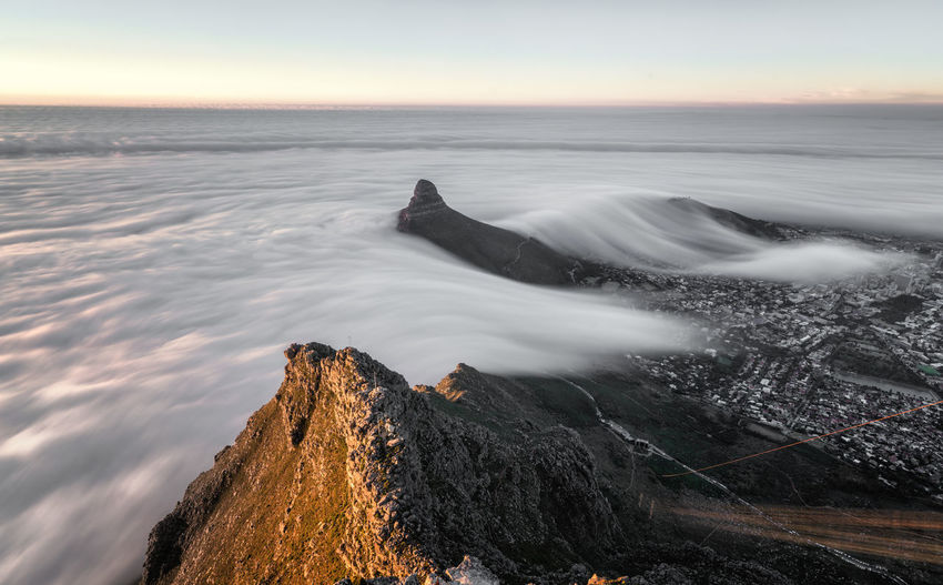 View from Table mountain above the fog entering from the ocean, Cape Town Nature Table Mountain Beauty In Nature Clouds Fog High Angle View Landscape Long Exposure Motion Nature No People Outdoors Physical Geography Rock - Object Scenics Sunset Table Mountain View Tafelberg Tranquil Scene Wave