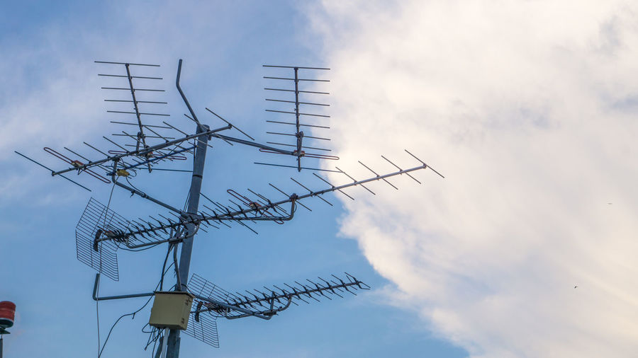 Alternative Energy Antenna Antenna - Aerial Architecture Built Structure Cloud - Sky Communication Connection Day Environment Environmental Conservation Global Communications Low Angle View Nature No People Outdoors Power Supply Renewable Energy Sky Technology Telecommunications Equipment Television Aerial