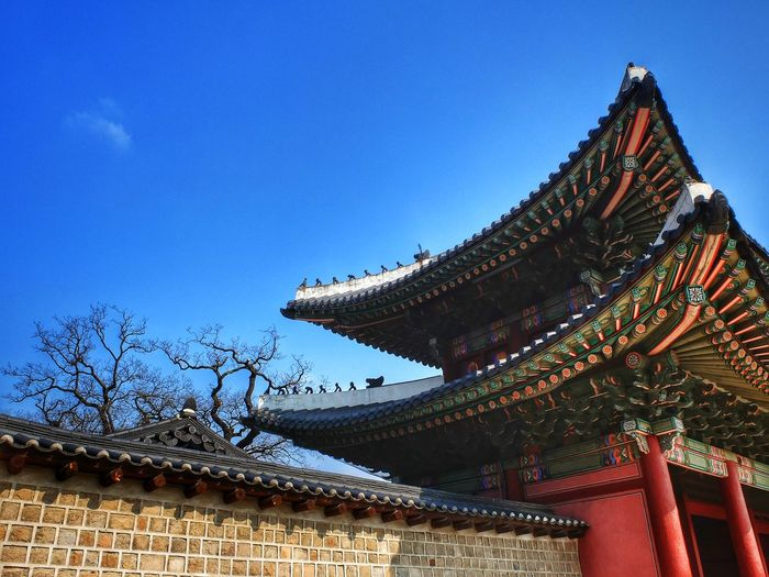 Low angle view of temple against blue sky