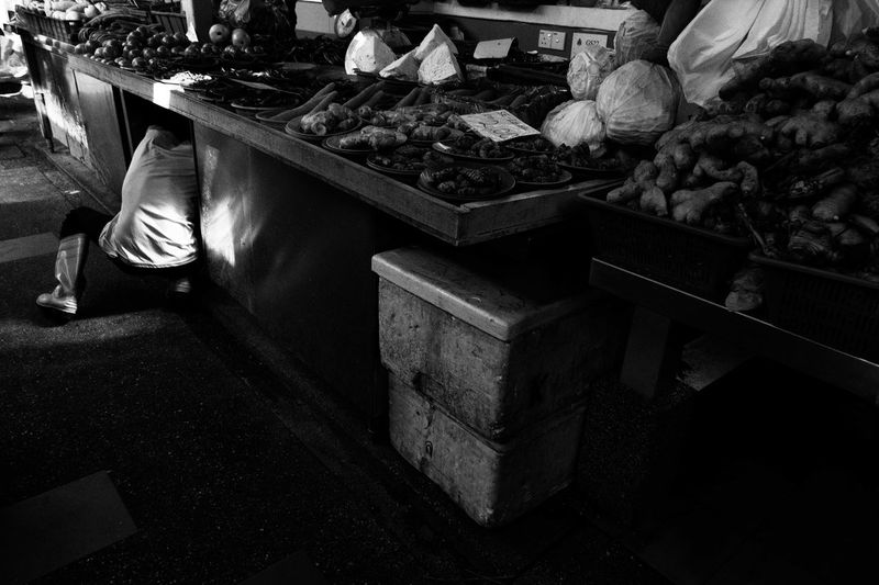 Neck Less : a street vendor taking out veges from his storage . Blackandwhite Candid Chowkit Faceless Food For Sale Freshness Kuala Lumpur Malaysia Market Market Stall Monochrome Outdoors People Retail  Streetlife Streetlifestyle Streetphotography Travel Destinations Vegetables Vendor Wetmarket Wetmarketscene Worker