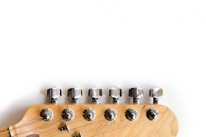 Electric guitar wooden color headstock in horizontal position detail on white background Brown Chords Detail Electric Guitar Headstock Music Musical Instrument No People String Stringed Instrument Symbol Tuning Pegs White Backgroud White Background Wooden