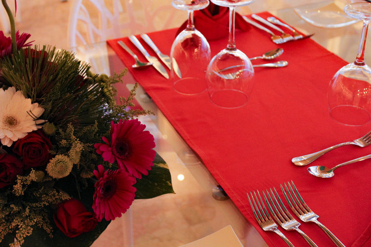 High angle view of flower bouquet by place setting