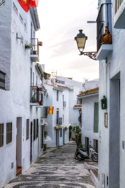 White-washed village of Frigiliana in Spain. Narrow streets and alleyways surrounded by white houses. Andalusia Architecture European  Home Malaga SPAIN Spain Flag Spanish Spanish Architecture Travel Alley Alleyway Architectural Detail Architectural Feature Axarquia Europe Frigiliana House Narrow Street Street Village White Background White Color White Washed White Washed Building