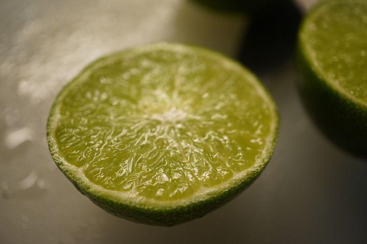 Close-up of lemon slice on table