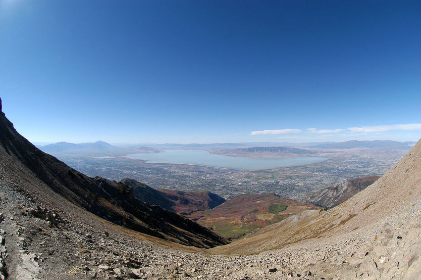 Top of Mount Timpanogos looking down on Utah Valley, Provo, and Utah Lake. Hiking to top of Timp. Reaching the top of a mountain, accomplishing a goal. Barren mountain at high altitude. Fish eye lens, blue skies. Arid Climate Beauty In Nature Day Landscape Mount Timpanogos Mountain Mountain Range Nature No People Outdoors Physical Geography Provo Scenics Sky Timpanogos Timpanogosutah Tranquil Scene Tranquility