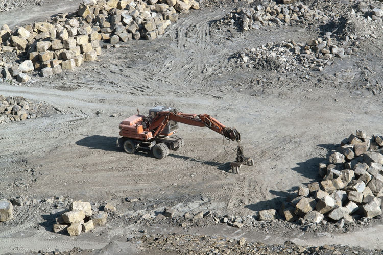 People working on rocks at construction site