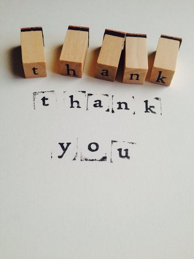Thank you printed with rubber stamped letters Stamped Stamps Rubber Lettering Letters Wording Thank Thank You Text White Background Paper