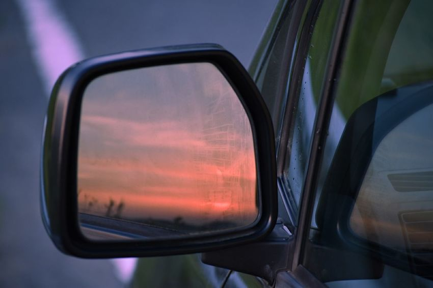 Car Reflection Transportation Window Mirror Side-view Mirror Sunset No People Outdoors Looking Through Window Close-up Road Trip Day Sky Vehicle Part Photography Themes Nature