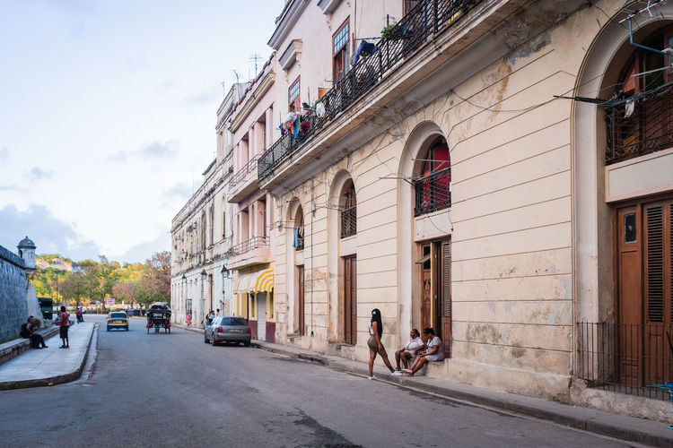 Hanging Out Cars Cuba Cuba Collection Havana Architecture Building Building Exterior Built Structure Canon Canonphotography City Day Group Of People Incidental People Real People Residential District Sidewalk Street Street Photography Streetphotography Transportation Vehicles Women