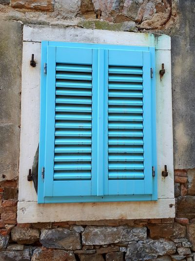 Ways Of Seeing Window Blue Light Blue EyeEm Selects Window Close-up Architecture Built Structure Building Exterior Closed Shutter Hinge Weathered Locked Peeling Off Bad Condition Worn Out Corrugated Latch EyeEmNewHere Summer In The City Springtime Decadence