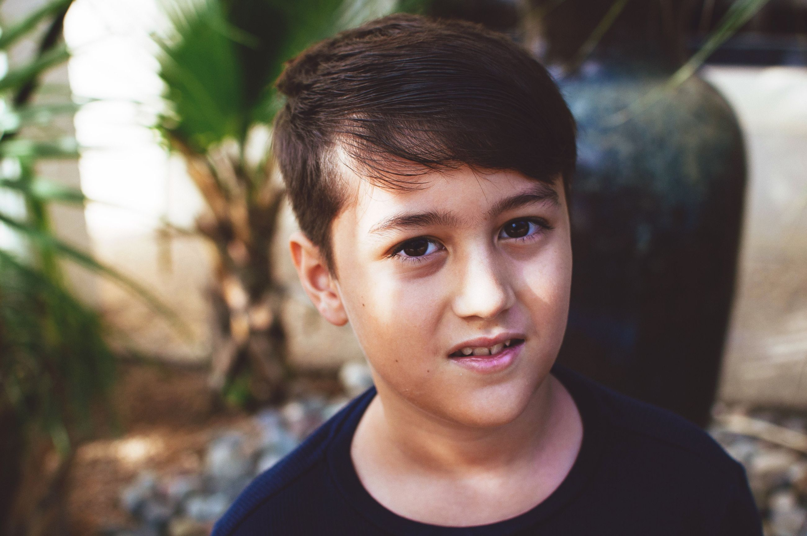 childhood, real people, one person, focus on foreground, boys, outdoors, casual clothing, day, portrait, looking at camera, leisure activity, headshot, lifestyles, happiness, close-up, people