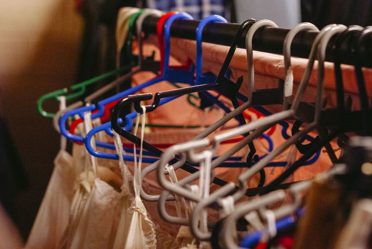 Selective Focus Close-up Coathanger Indoors  Rack Large Group Of Objects Hanging Multi Colored Clothes Rack No People Cable Collection Focus On Foreground Sport Clothing In A Row Connection Complexity Tangled Costume Store Costume Theatre Backstage