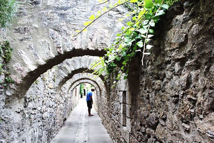 Full Length One Person Mid Adult Walking Rock - Object Adult People One Man Only Tunnel The Way Forward Day Rear View Adults Only Only Men Leisure Activity Tree Real People Architecture Nature Men à VillefrancheDeConflent Pyrénées-Orientales Vauban