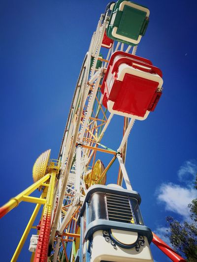 Amusement Park Arts Culture And Entertainment Rollercoaster Fun Amusement Park Ride Low Angle View Ferris Wheel Sky Blue Multi Colored Excitement Outdoors Clear Sky No People Day