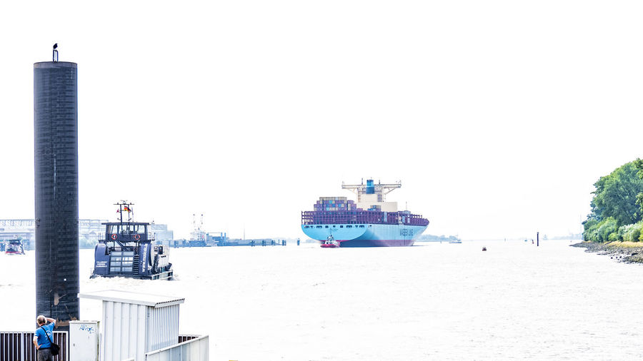 elbe Container Ship Elbe River Mearsk Architecture Building Exterior Built Structure City Clear Sky Day Downward Travel Harbor Highkeyphotography Nautical Vessel No People One Man Outdoors Ponton Sea Sky Teufelsbrück