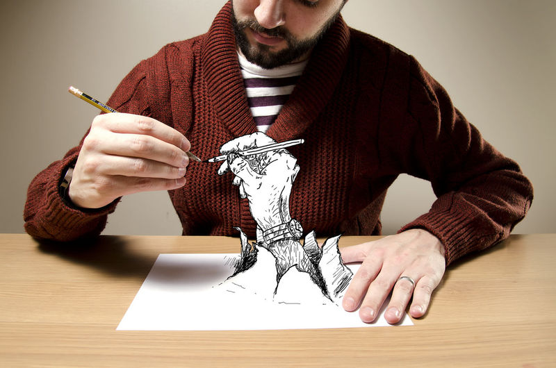 Midsection of man working on table against white background