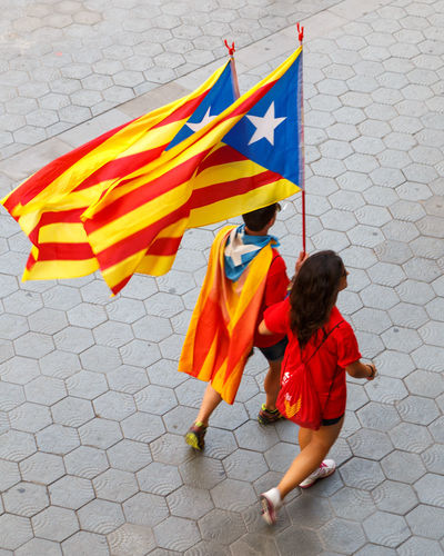 Catalunya. Catalan Catalonia Catalunya Flags Parade Patriotism Patriots  People Protest Protesters Rear View Red Street Walking Yellow