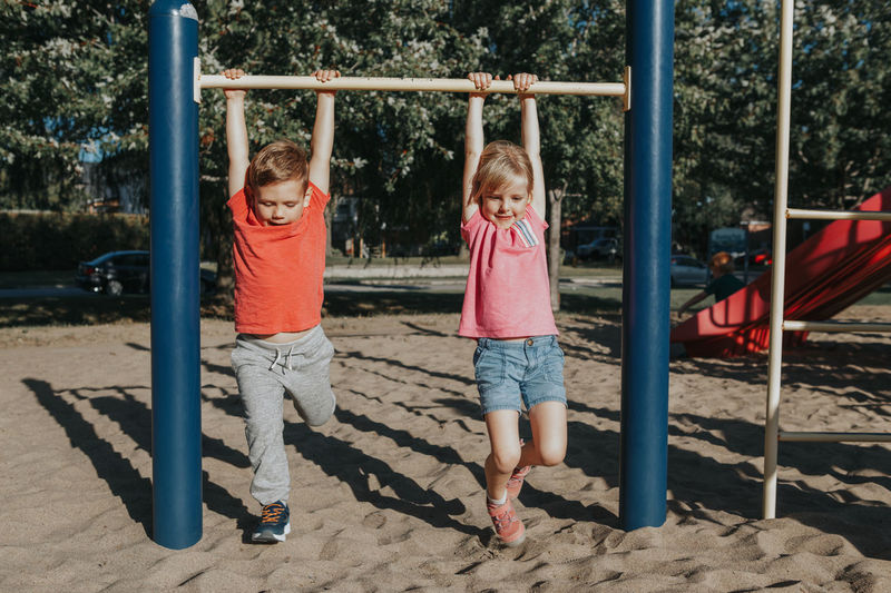 Full length of kids playing at playground