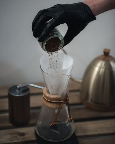 Coffee Brewing and Coffee Making Ijas Muhammed Photography Human Body Part Preparation  Indoors  Human Hand Coffee Coffee Maker Appliance Hand Coffee - Drink Refreshment Holding Unrecognizable Person One Person Food And Drink Drink Pouring Body Part Container Cup Coffee Pot Finger