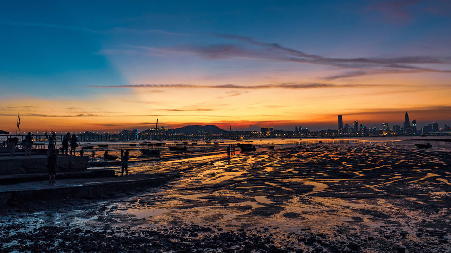 Water Sea City Sunset Beach Sand Business Finance And Industry Sky Horizon Over Water