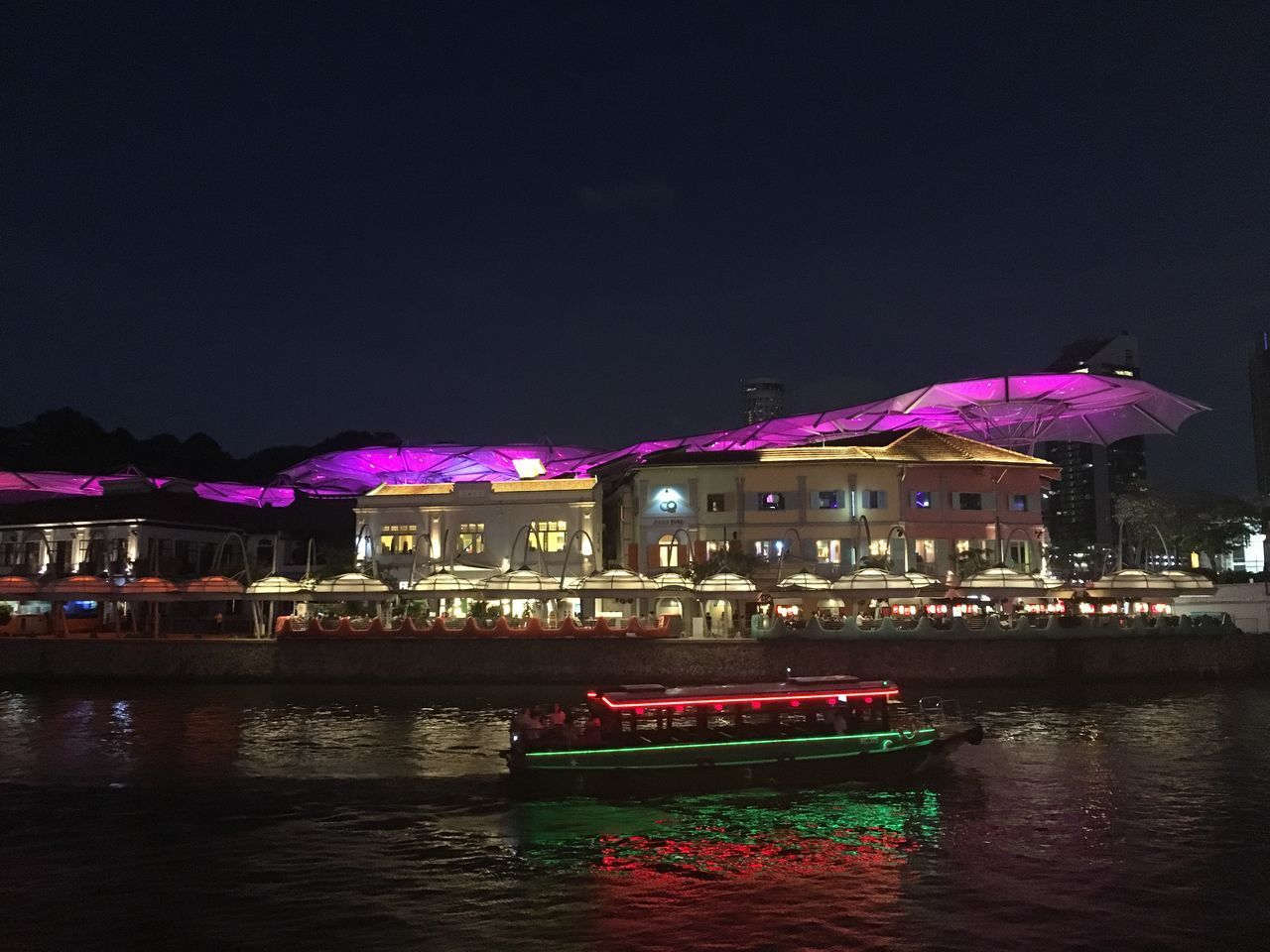 water, illuminated, night, waterfront, sky, built structure, architecture, building exterior, reflection, nautical vessel, nature, city, river, no people, transportation, mode of transportation, building, outdoors, pink color, purple