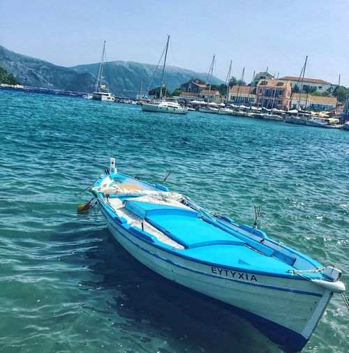 Boat in Fiscardo bay, Kefalonia, Greece Nautical Vessel Mode Of Transport Sea Boat Outdoors Waterfront Blue Sky Scenics Harbor Beach Life Travel Photography Traveling Home For The Holidays Traveller