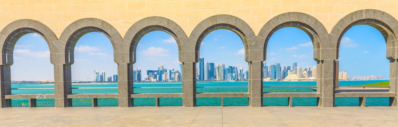 Cityscape and sea seen through arch