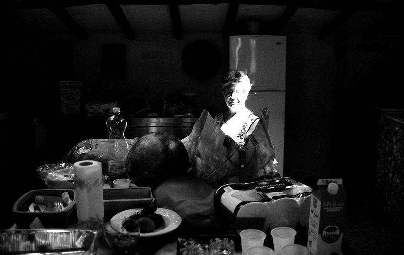 Light of the house. Mix Yourself A Good Time The Week On EyeEm EyeEmNewHere Light Woman Portrait Mother Light House Lifestyles Working Hard Cooking Cooking At Home Summer Vacation Many Things To Do Indoors  Filmphotography Film Is Not Dead Film Noir Filmisalive 35mm Film Photography BW_photography Portraits Noir Et Blanc Analogue Photograhy Black & White Photography Woman Second Acts Black And White Friday This Is Aging Focus On The Story