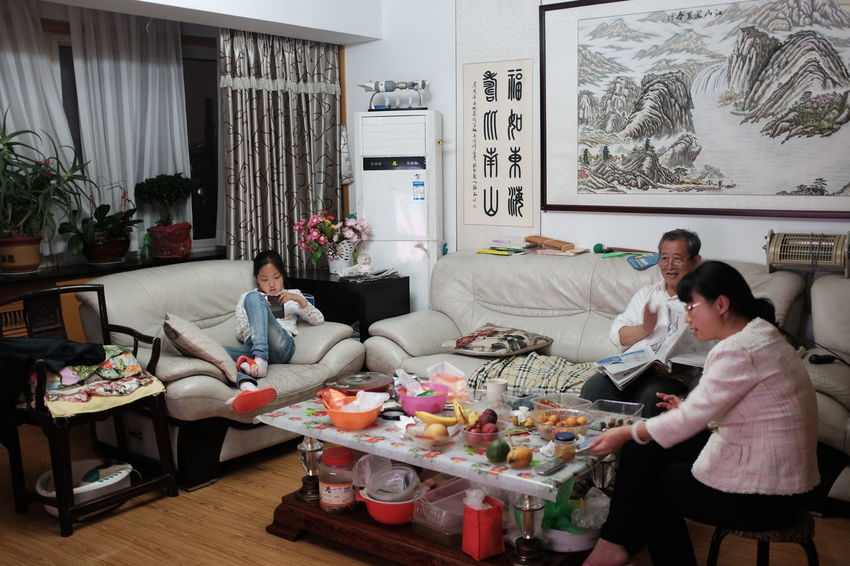 A family after dinner,qingdao,china,2016. 2016 EyeEm Awards Casual Clothing China China City Life China Family Desk Domestic Room Family Members Family Time Leisure Activity Lifestyles Love Qingdao Relationship Relaxation Sitting Sofa China 2016 People Here Belongs To Me Fujifilm X100THome Is Where The Art Is