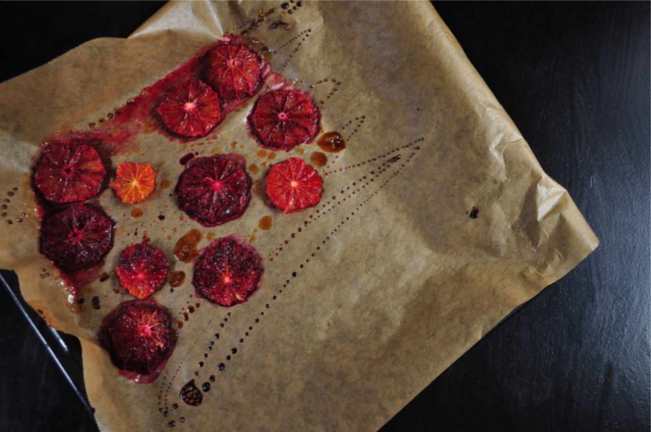 High Angle View Of Blood Orange Slices On Paper