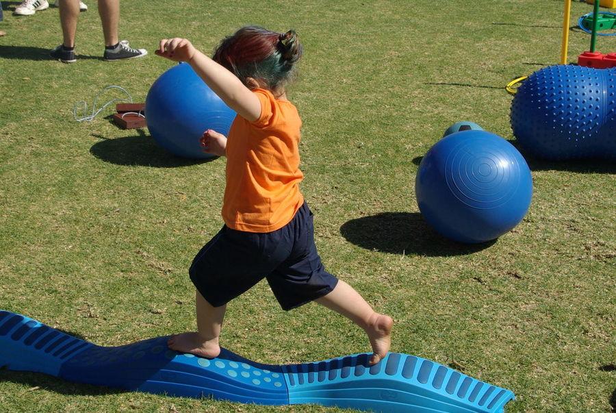 Balancing Act Ball Ballance Blue Childhood Day Enjoyment Fun Grass Grassy Lawn Leisure Activity Lifestyles Outdoors Playful Playground Playing