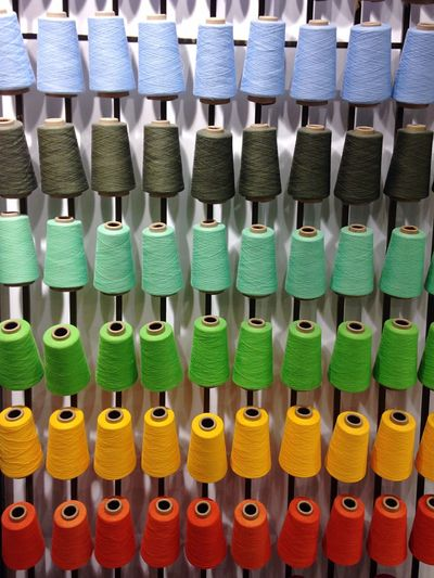 Full Frame Shot Colorful Thread Spools On Machine