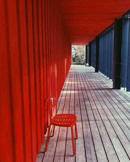 Empty chairs in corridor of building