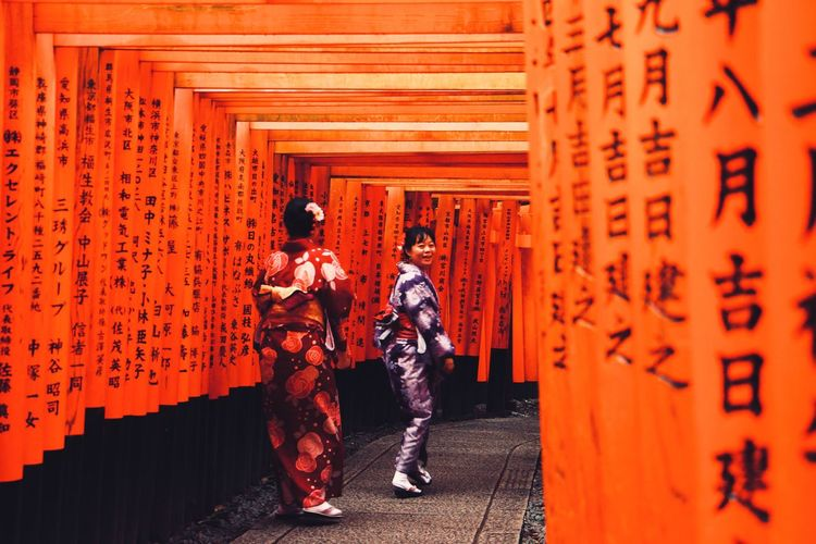 Fushimi-Inari Fushimi Inari Shrine Japan Kyoto Japan Photography City Travel Destinations Geisha Gion Arches Architecture Cultures Cultural Shrine Of Japan Shrine Temple Religious  Religion Shinto Shrine Orange Color Women Dress Full Length Walking Architecture Travel Gate Historic Door Adventures In The City The Street Photographer - 2018 EyeEm Awards The Traveler - 2018 EyeEm Awards