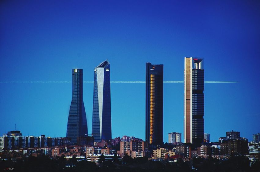 4 torres Madriz #madrid #callejeando #madrid City Cityscape Urban Skyline Skyscraper Modern Illuminated Business Clear Sky Business Finance And Industry Blue Office Building Skyline Tower Office Building Exterior