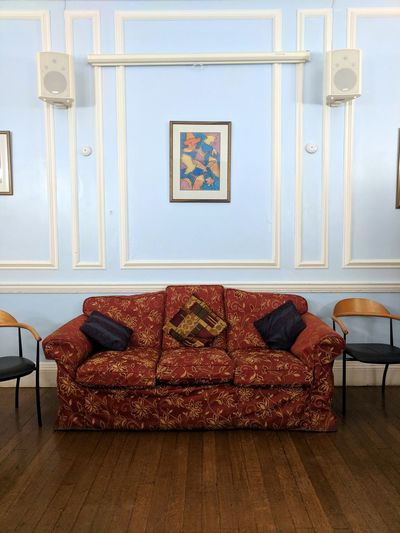 Red sofa on blue background wall Blue Wall Red Sofa Vintage Chair Home Interior Home Showcase Interior Armchair Indoors  No People Living Room Sofa Old-fashioned Furniture Day Luxury