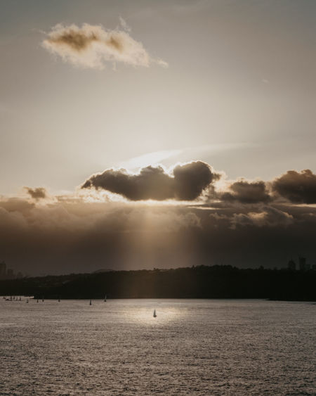 Sky Cloud - Sky Water Scenics - Nature Beauty In Nature Tranquil Scene Tranquility Sea Nature No People Waterfront Sunset Outdoors Day Non-urban Scene Land Environment Sunlight Candid Boat Sailboat Sydney Harbour  Ocean Rays Of Light