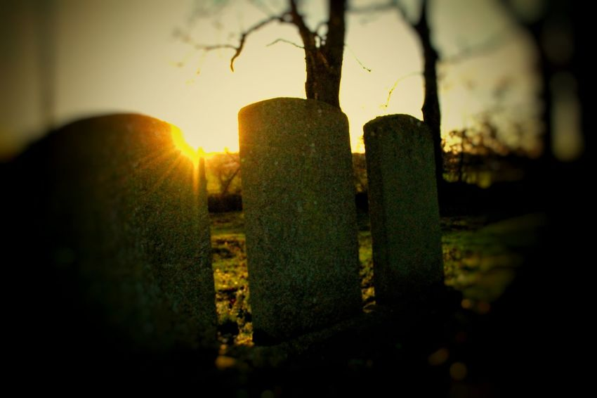 local abandonded graveyard dating back to mid 1800s... Churchyard Headstone Shadows Spooky Atmosphere Tombstones Silhouette Abandoned Graveyard Beauty Gravestone Spooky Graves My Own Unique Style Sunset Sunset EyeEm_abandonment Nature Vs Humanity Headstones In A Row Up Close Street Photography EyeEm Gallery Twilight Memorial Abandoned Cemetery Cemetery_shots Cemetery Abandoned Graveyard