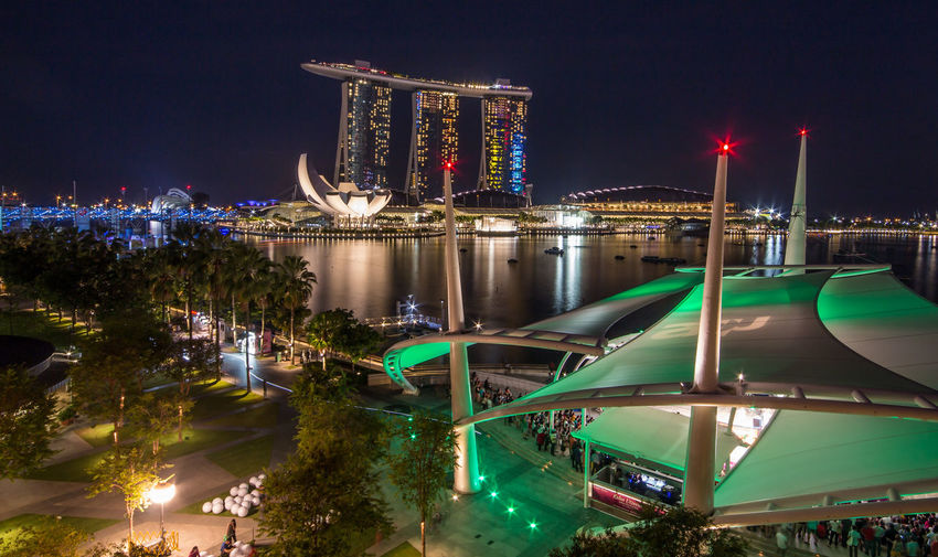 Sea By Illuminated Marina Bay Sands Against Clear Sky At Night