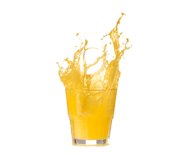 Close-up of yellow drink against white background