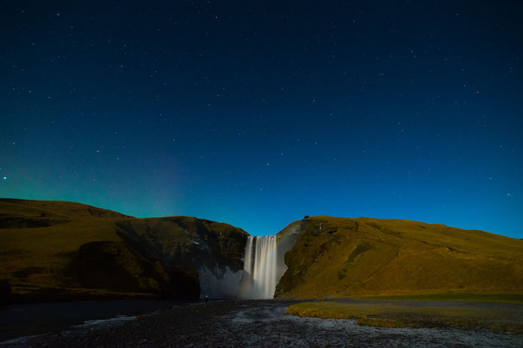 night glow of the aurora Astronomy Aurora Borealis Beauty In Nature Clear Sky Long Exposure Motion Mountain Nature Night Night Waterf No People Outdoors Scenics Sky Star - Space Water Waterfall