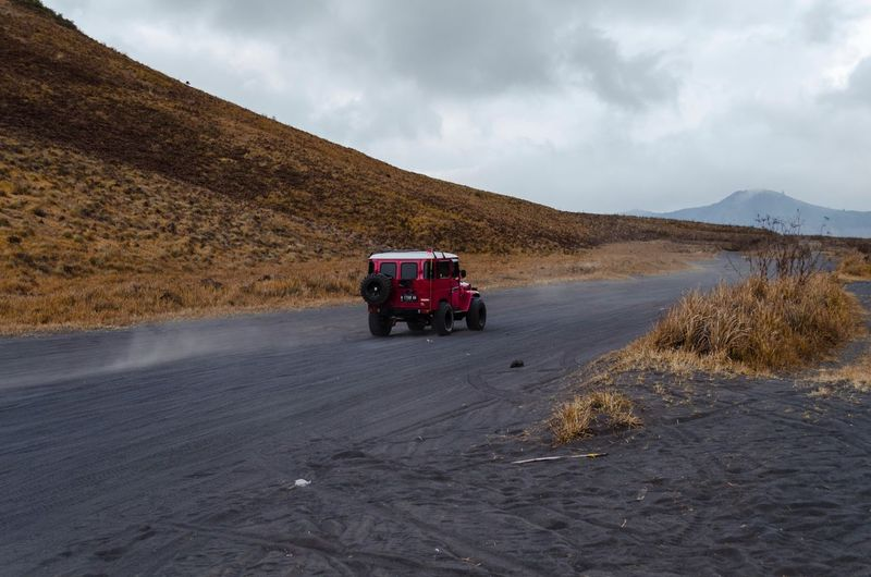 Jeep across the mountain at Bromo, the suitable transport when we are in Bromo cause its road sometimes mountain and desert. Jeep Travel Photography Travel Destinations Travel Bromo Tengger Semeru National Park Bromo Mountain Bromo Transportation Mode Of Transportation Cloud - Sky Land Vehicle Sky Nature Land Scenics - Nature Mountain Desert Day Travel Landscape Road Off-road Vehicle Environment Beauty In Nature Motor Vehicle Non-urban Scene Sand